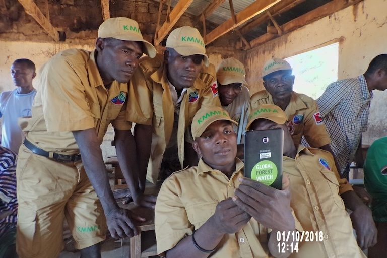 Members of a village patrol, equipped with smartphones to log incidents of deforestation. Image courtesy of Durrell Wildlife Conservation Trust.
