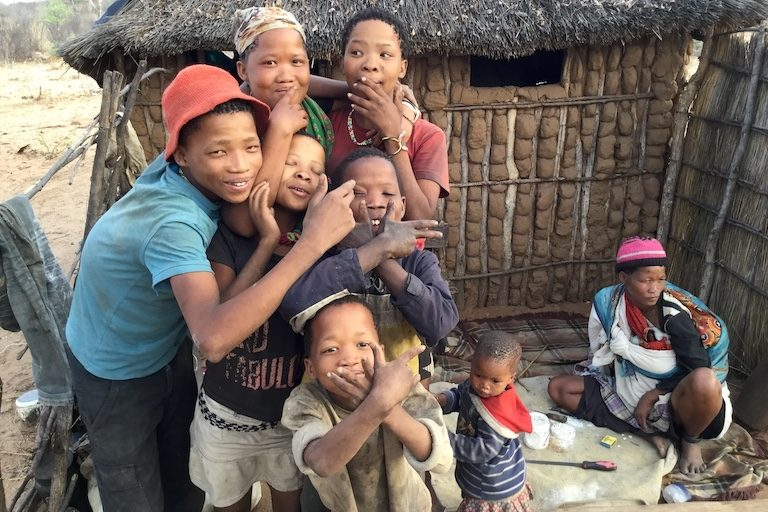San children, hamming it up for the camera at one of the villages. Image by John Grobler for Mongabay.