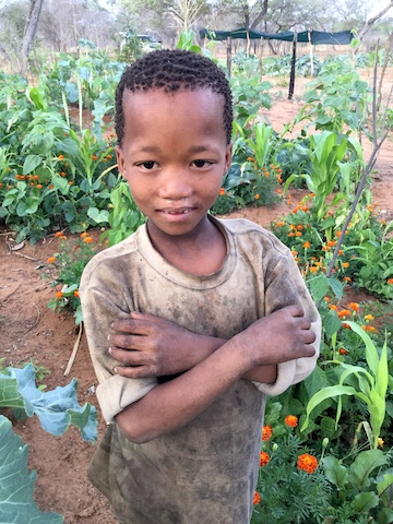 A small boy in his father's carefully tended garden. Image by John Grobler for Mongabay.