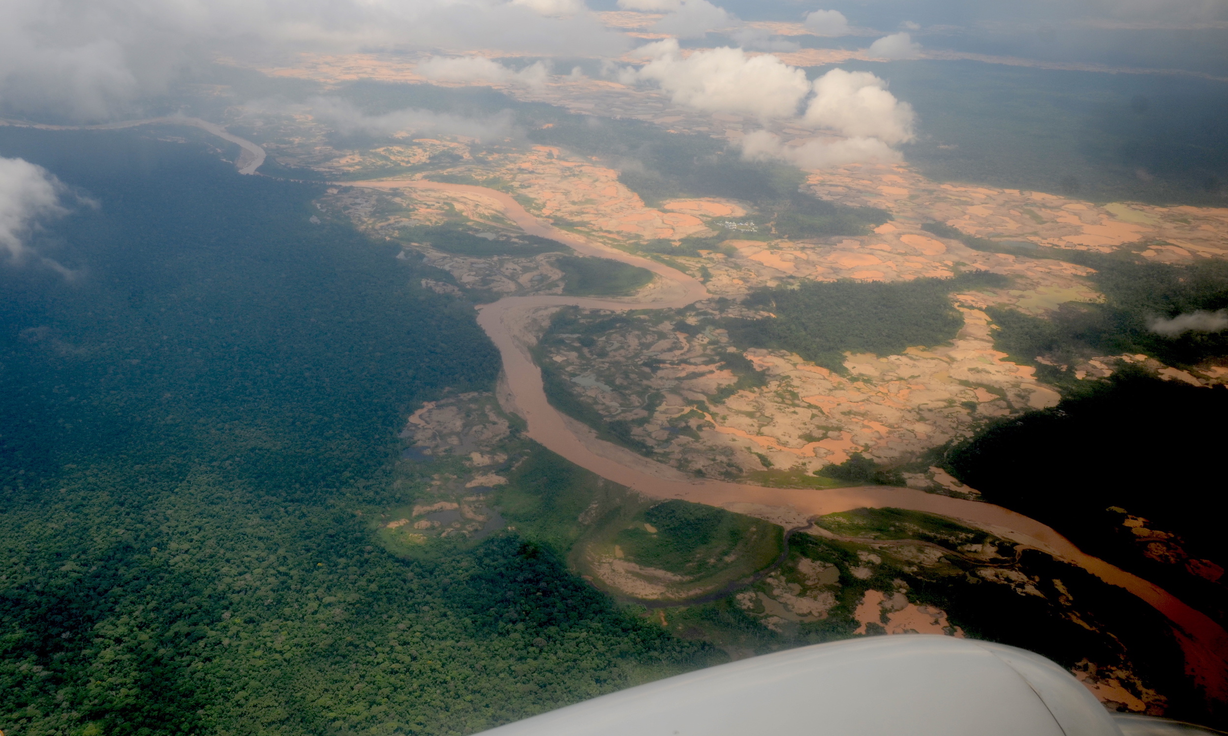 From the air, the devastating effects of illegal gold mining are apparent on both sides of the Malinowski River in Tambopata National Reserve. Image by Yvette Sierra Praeli.