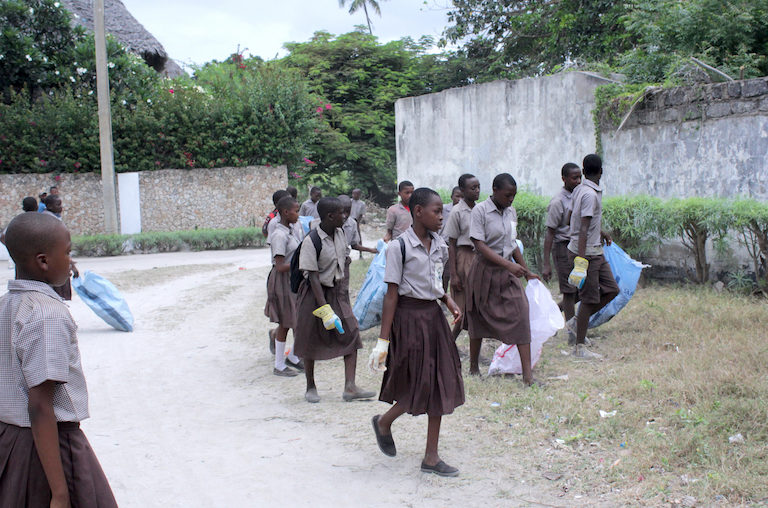 Watamu school children help clean their village. Image by Anthony Langat for Mongabay.Watamu school children help clean their village. Image by Anthony Langat for Mongabay.