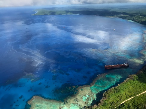A large oil slick emanates from the the MV Solomon Trader after it ran aground near Rennell Island on Feb. 5. The oil has contaminated the ecologically delicate area in the Solomon Islands. Image courtesy of Australian Dept of Foreign Affairs & Trade.