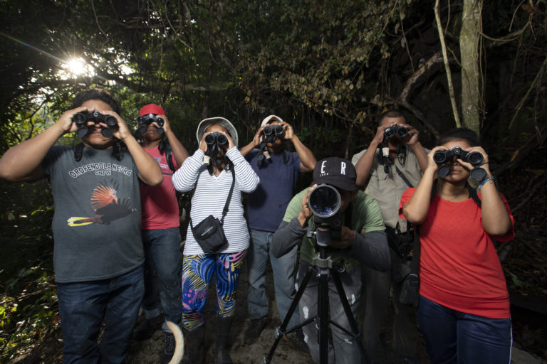 A Wounaan bird-watching group from the community of Puerto Lara during a hike in the local forest. Image by Alexander Arosemena for Mongabay.
