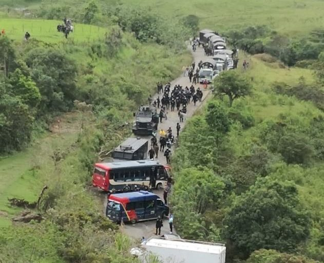 Indigneous protesters in the Cauca department of southwestern Colombia are directly in the path of armed military. Image via @ONIC_Colombia on Twitter.