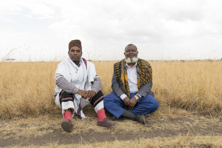 Aba Gada Kabeto Edamo Wabe(r), leader of the Oda Roba and Aba Gada Azmach Teshita, Sammato Bullo (l) leader of the Hambentu clan pose for a portrait inside Senekele Swayne's Hartebeest Sanctuary. Photo by Maheder Haileselassie Tadese.