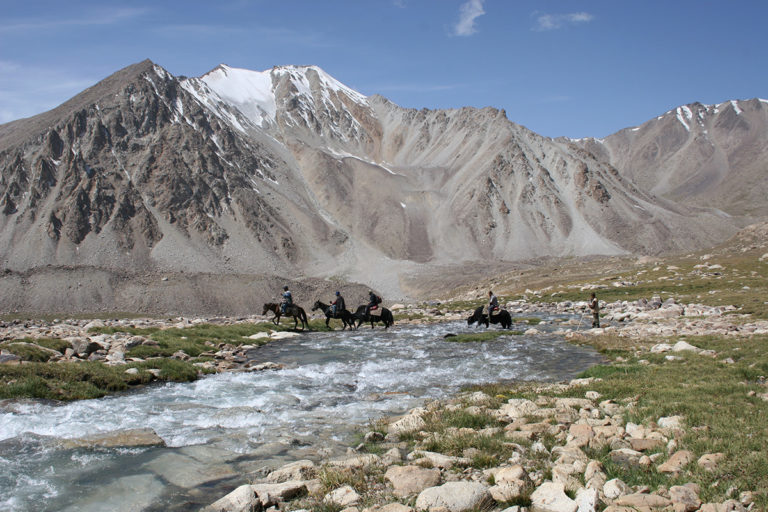 WCS teams cross a small river in the Big Pamir, within the Wakhan Peninsula, which became part of Afghanistan's second national park. Courtesy of WCS/Don Bedunah.