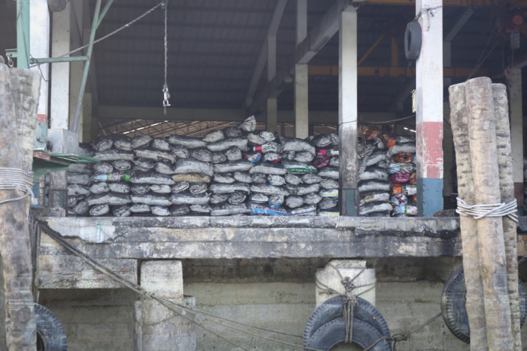 A charcoal warehouse in Ranong. Photo by Victoria Milko.