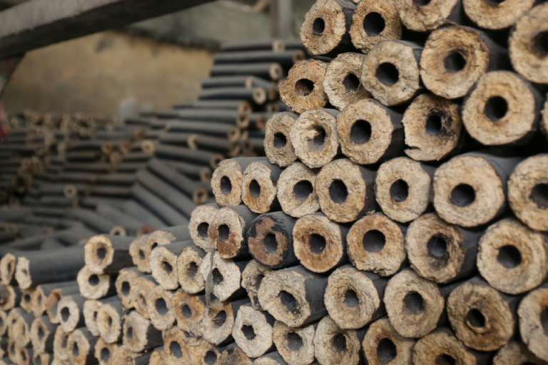 Rice husk bricks before they are broken up for sale. Photo by Victoria Milko.