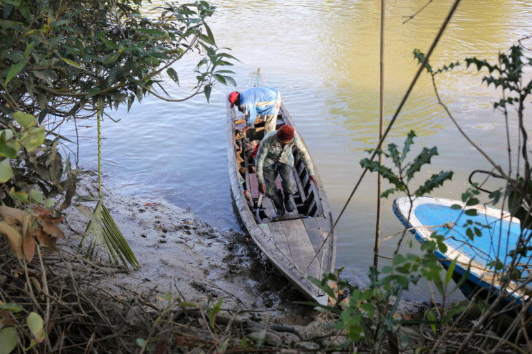 Illegal mangrove harvesters with their boat in the Irrawaddy Delta. Photo by Victoria Milko.