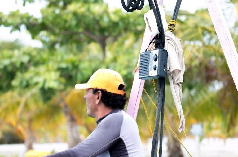 A radio hangs on a Belizean fishing vessel. Photo by J. Sanchez for WCS.
