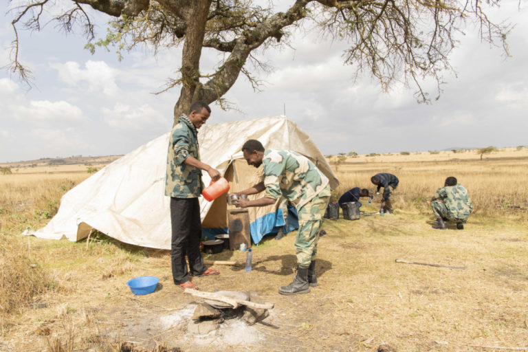 Rangers and scouts prepare for lunch on a recent day at Senekele Swayne's Hartebeest Sanctuary. Photo by Maheder Haileselassie Tadese.