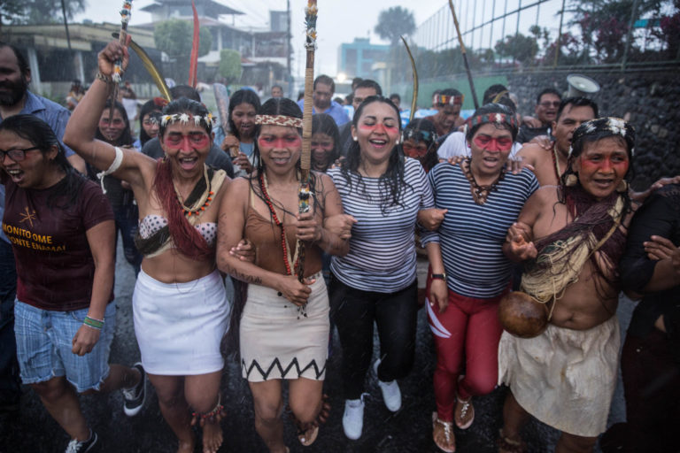 Indigenous Waorani march through the streets of Puyo after their legal victory against the government, during a strong downpour. Photo by Mitch Anderson/Amazon Frontlines.