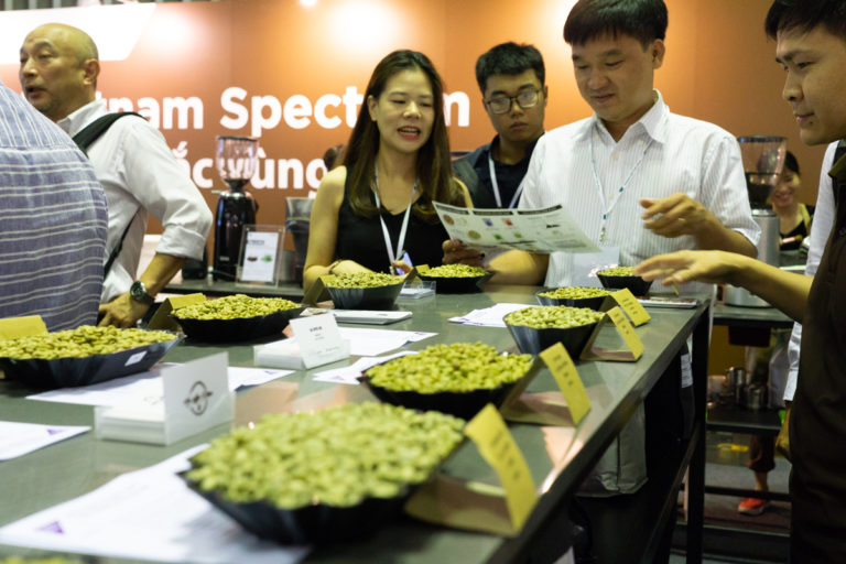 Coffee farmers and specialists discuss beans grown in Vietnam's Central Highlands at the recent Cafe Show Vietnam in Ho Chi Minh City. Photo by Michael Tatarski for Mongabay.