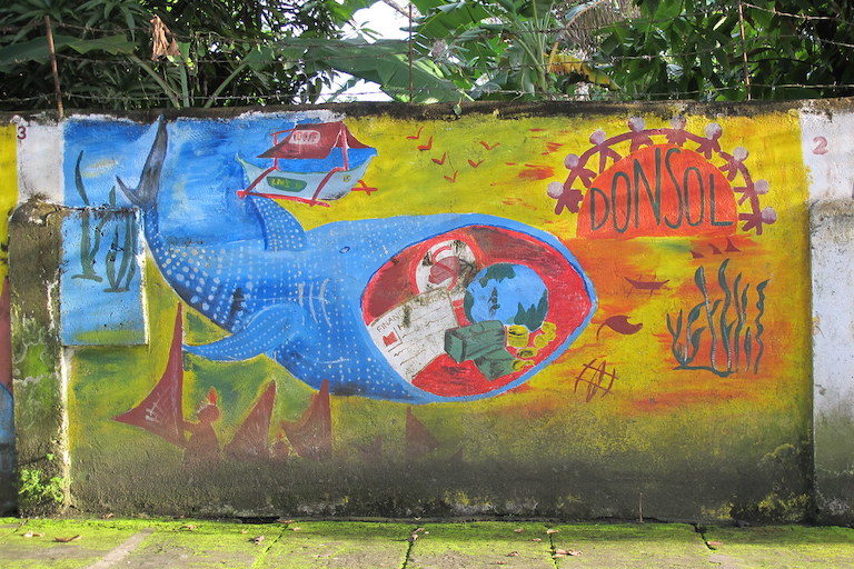 A mural in Donsol, the Philippines, shows some of the benefits of whale shark tourism. Photo taken in 2012. Image by 533338 via Flickr (CC BY-NC 2.0).