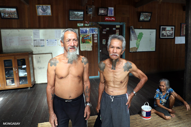 Apay Janggut, also known as 'Bandi', and Kudi in the rumah betang or longhouse at Sungai Utik. Photo by Rhett A. Butler