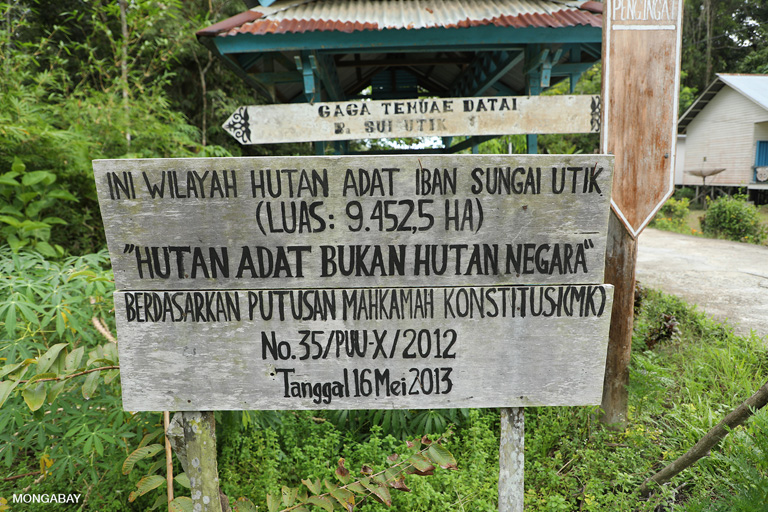 "Sign in front of Sungai Utik longhouse. ""Utik"" means ""white"" or ""clear"" in Iban. It refers to the crystalline creeks that flow through the tribe's customary forest. Photo by Rhett A. Butler"