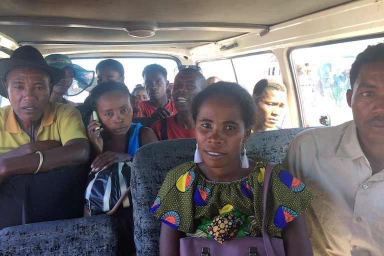 Emma Vazonandrasana and others in a bush taxi on the way home to the village of Benetse. They'd gone to Fianarantsoa, a city in the country's central highlands, to support nine friends and family members who'd been detained for their alleged role in the destruction of Base Resources's property. Image by Edward Carver for Mongabay.