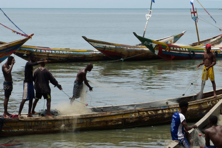 Fishermen arrange their gear in Tombo. Many local artisanal fishermen supported the recent one-month closure of Sierra Leone's waters to fishing by industrial vessels. Image by Uzman Unis Bah for Mongabay.