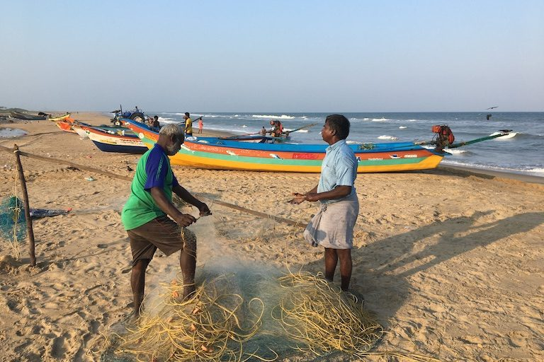 Members of the traditional fishing village of Urur-Kuppam in the southern Indian state of Tamil Nadu tend their gear. Increased competition and climatic changes are affecting the livelihood of such communities. Image by Vaishnavi Chandrashekhar.