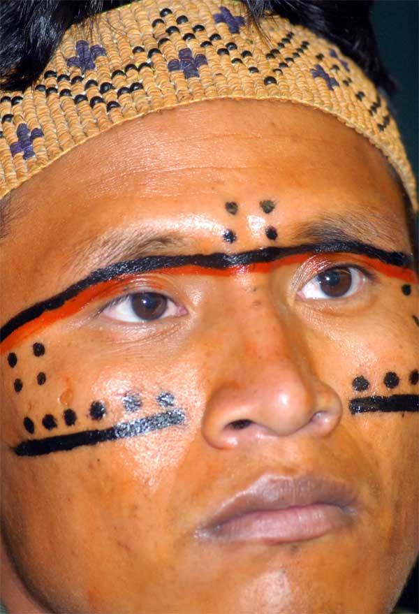 Traditional Yanomami face painting. The Yanomami were decimated by a previous mining invasion in the late 1980s when many died. Elders fear that this new invasion will have similar devastating impacts. Image by Fabio Rodrigues Pozzebom / Agência Brasil.