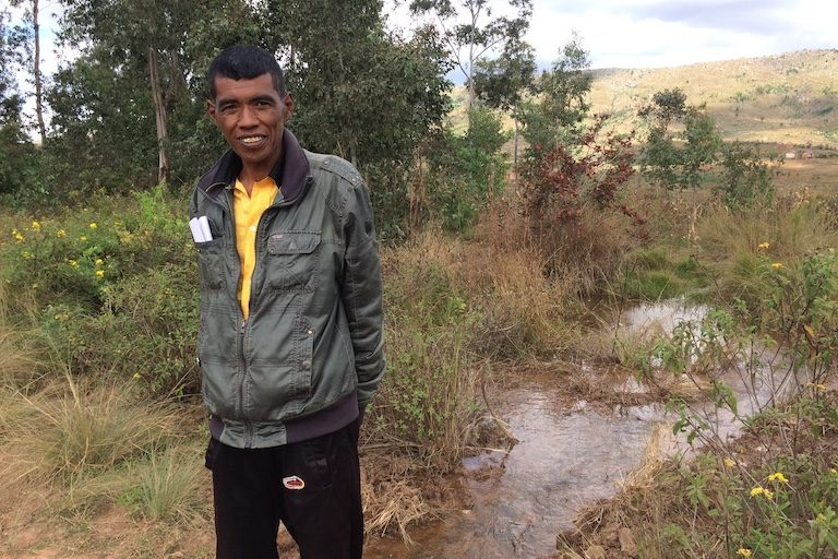 "Noely Ranaivosolo, a rice farmer and the president of a community group that formed in opposition to the dam project. His family has farmed the land for generations. ""They just want to give us money. But we're not sure how we will live,"" he said. Image by Edward Carver for Mongabay."