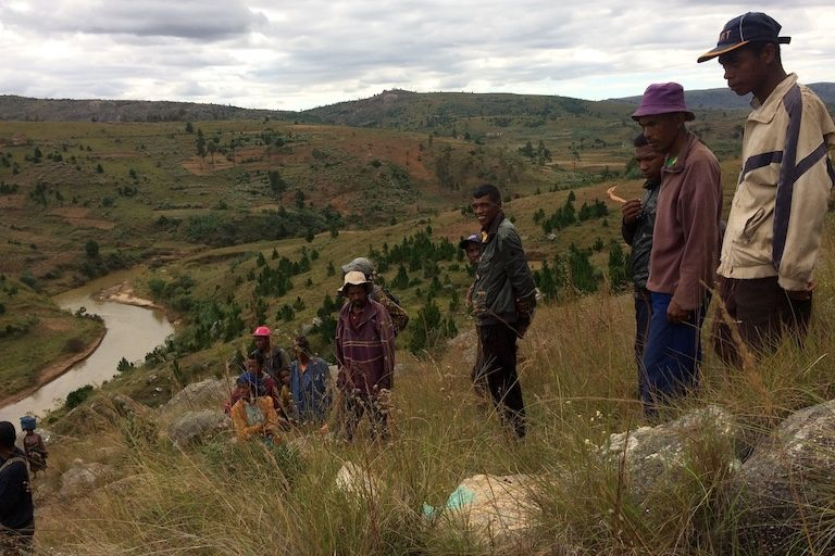 Villagers from Farihitsara gather near the proposed dam site. Tozzi Green, the Italian company responsible for the hydroelectric project, marked some of the rocks when it did research at the site. Image by Edward Carver for Mongabay.