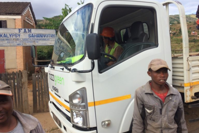A Tozzi Green truck drops off day laborers from its nearby power plant in the village of Sahanivotry. Image by Edward Carver for Mongabay.