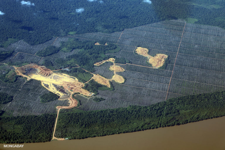 Deforestation for palm oil and mining as seen from an airplane above Indonesian Borneo. Photo by Rhett A. Butler.