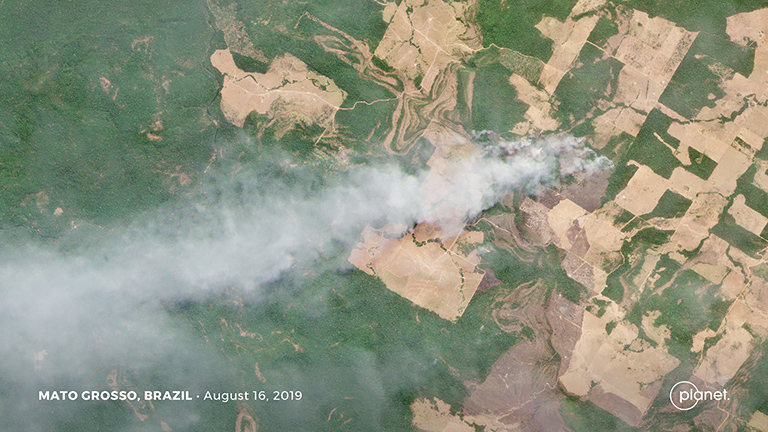 This Planet image shows a fire burning in an area of recent forest clearing in Mato Grosso, Brazil. The utility of Planet's data has spurred speculation that its constellation could be used by the Brazilian government to replace INPE's deforestation monitoring system. But Planet has denied negotiating with the Brazilian government on such a plan. Courtesy of Planet Labs Inc.