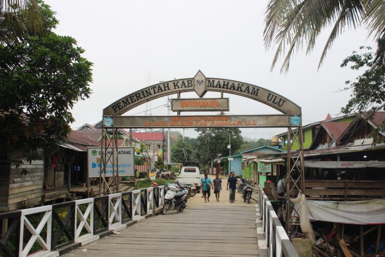 A remote Indonesian district juggles road building with