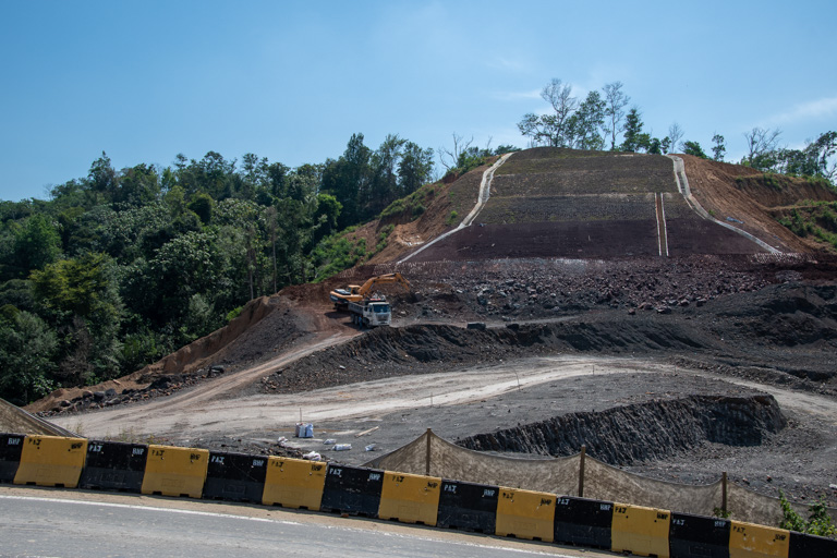 A hillside cleared of trees next to the Pan Borneo Highway. Image by John C. Cannon/Mongabay.