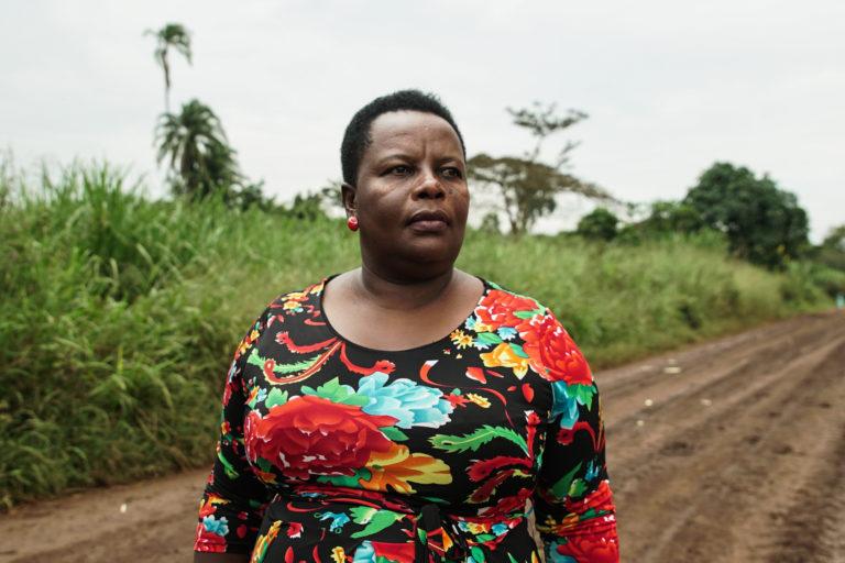 Beatrice Rukanyana looks out over a sugar plantation near Bugoma Forest. Photo: Thomas Lewton