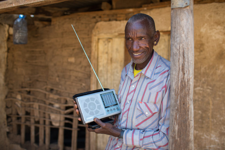 By some estimates, 80% of households across Africa have a radio, making it a potentially powerful channel for communicating agricultural information. Image courtesy Simon Scott/Farm Radio International
