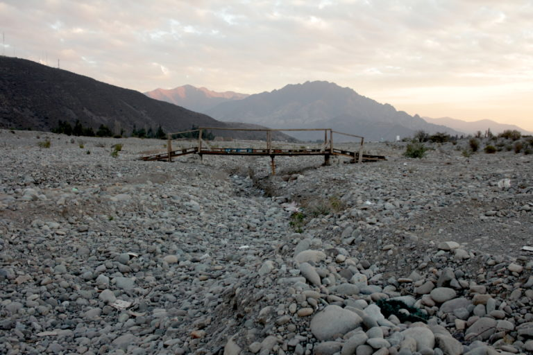 The Putaendo River hasn't had water for years, and it has become a dumpsite. Image by Michelle Carrere.