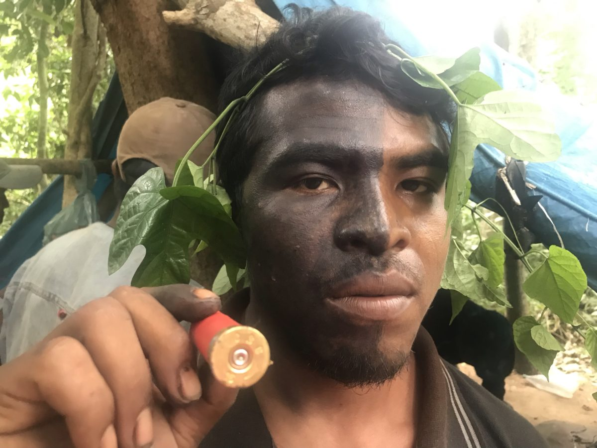"Indigenous Guajajara leader Paulo Paulino Guajajara was shot dead in his head in an ambush by loggers in the Amazon. He was one of the ""Guardians of the Forest,"" a group of Guajajara indigenous people that risks their lives fighting illegal logging in the Araribóia indigenous reserve. He posed for this photo with a bullet found in an illegal logging camp in Araribóia on Jan 31, 2019. Image by Karla Mendes/Mongabay"