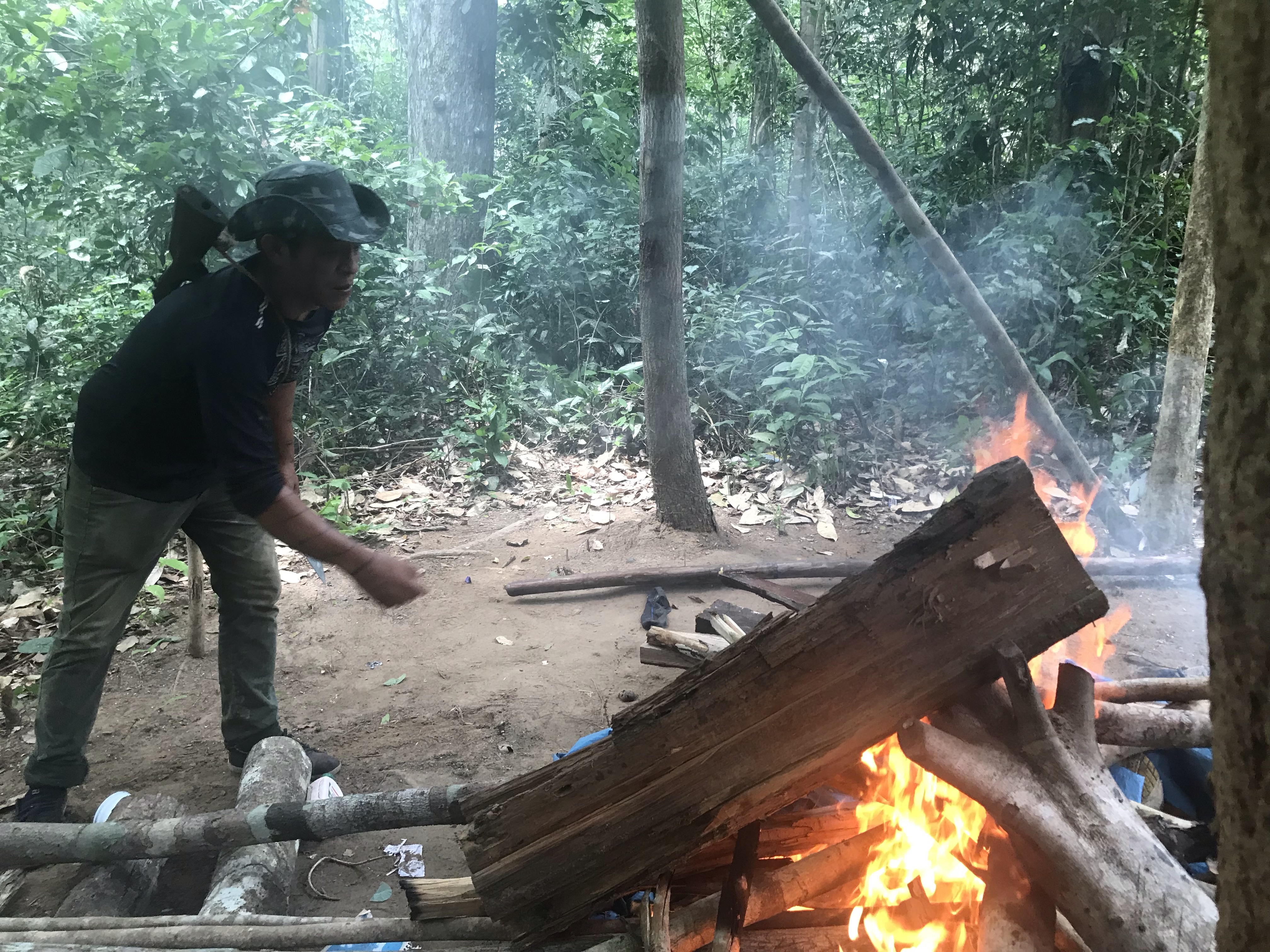 Indigenous Guajajara leader Laércio Guajajara, also a Guardian, was hit by two grazing shots by loggers in the Amazon. In this photo, he sets fire to an illegal logging camp on Jan 31, 2019. (Photo: Karla Mendes/Mongabay)