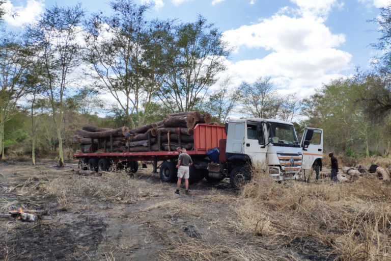 Inspecting a confiscated truck belonging to illegal loggers. Image courtesy Peace Parks Foundation.