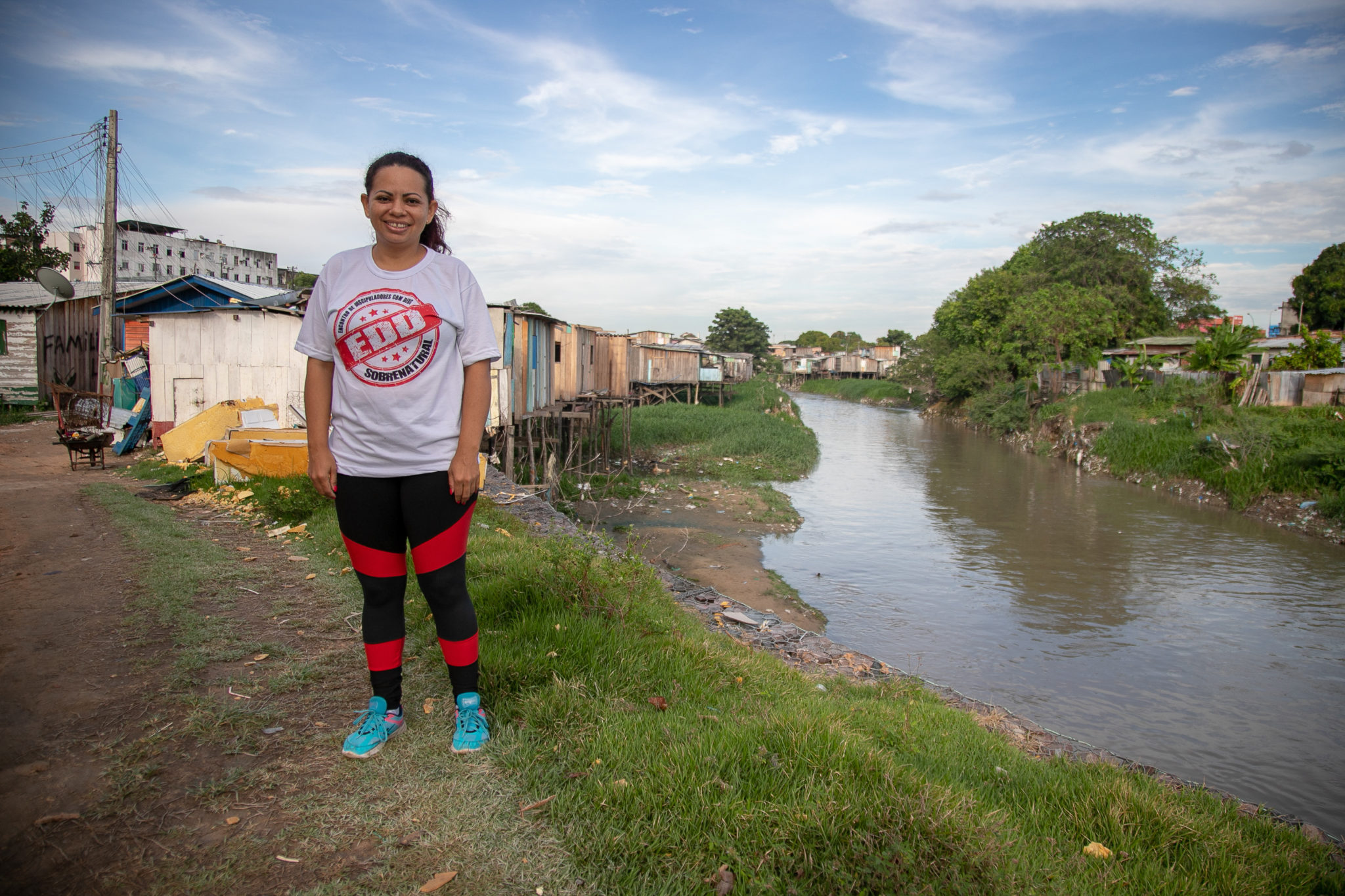 Manaus resident Cristina Santos poses for a photo in the favela community where she lives, in the Raiz neighborhood, an hour's drive from Manaus's famous Amazon Theatre. Image by César Nogueira.