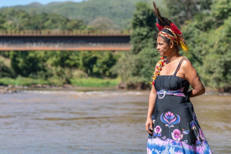 Shaman Angohó Ha-ha-hãe, one of the leaders of Naô Xohã indigenous village, poses for a photo close to the Paraopeba River. The Naô Xohã community is requesting to be temporarily relocated by Vale due to the river pollution. Image by Luiz Guilherme Fernandes for Mongabay