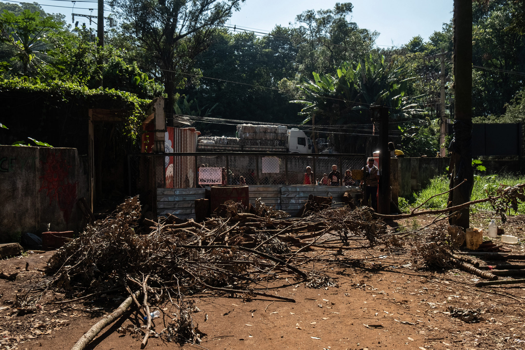 A view of the lot in dispute between Guarani indigenous and Tenda construction company from inside. Guarani indigenous put trees in front of the gate to enable the police from entering inside the area.Image by Tommaso Prottifor Mongabay