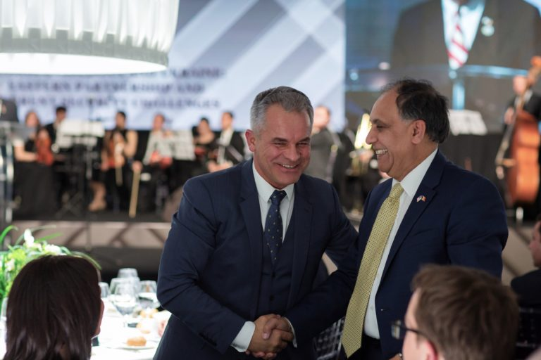 Vladimir Plahotniuc and Asif Chaudhry shake hands at a meeting with the Atlantic Council in 2018.