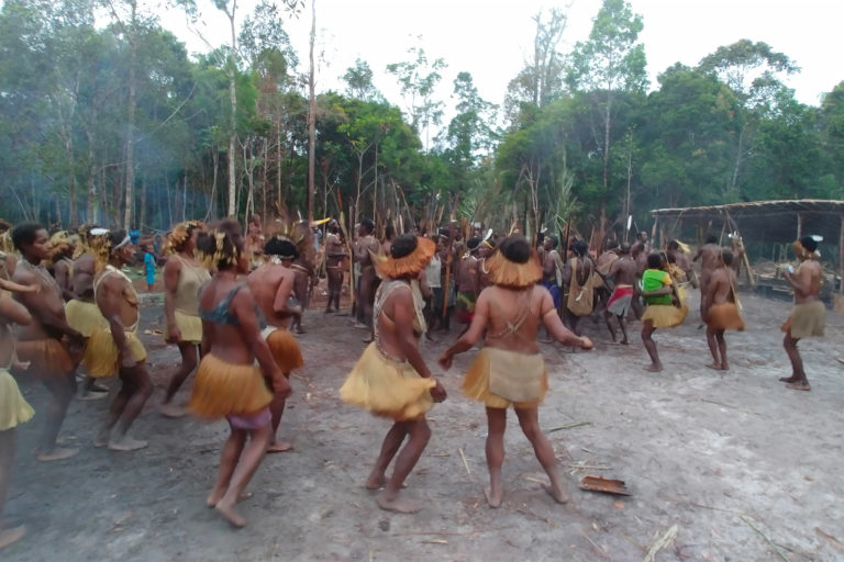 The Kombai people dance during the sago grub feast in Boven Digoel, Papua. Image by Hans Nicholas Jong/Mongabay.
