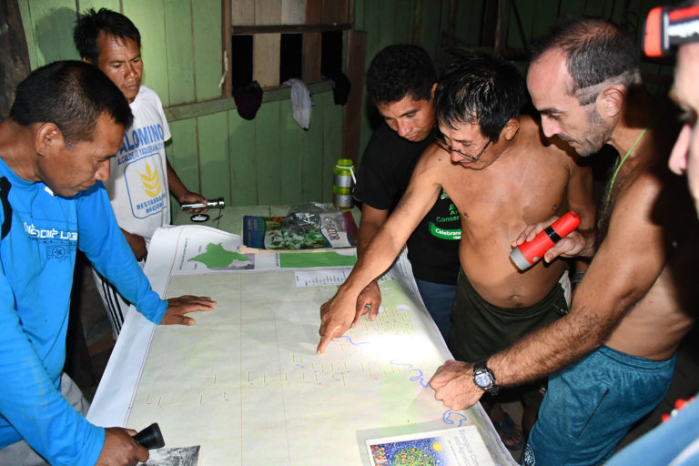 Matsés mapping team from Nuevo San Juan meets with Acaté staff to review maps. Photo: Acaté