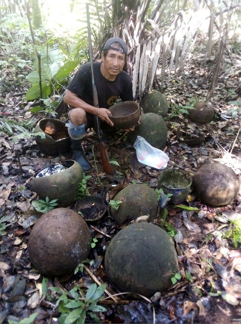 Clay pots mark the site of a longhouse that was hastily abandoned following a skirmish with Peruvian soldiers over 70 years ago. Photo: Acaté