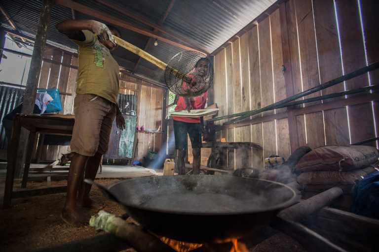 A Papuan woman making sago noodles at her house in Sira village, Teminabuan, South Sorong, West Papua. Sago is a starch extracted from the pith of various tropical palm stems. Credit line: © Jurnasyanto Sukarno / Greenpeace