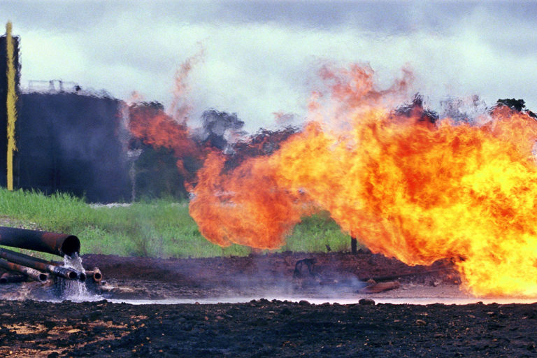 Oil waste pit fire in Shushufindi in 1993 at a facility built by Texaco. Photo by Lou Dematteis