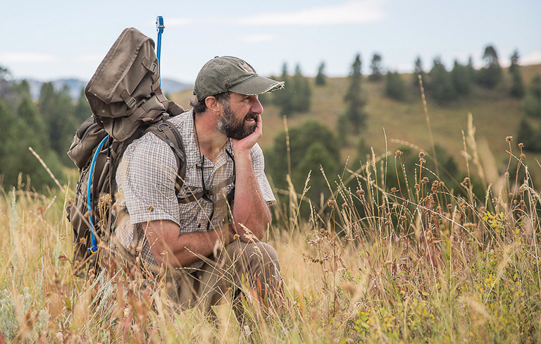 Biologist Mark Elbroch in the field. Image by Dave Moskowitz.