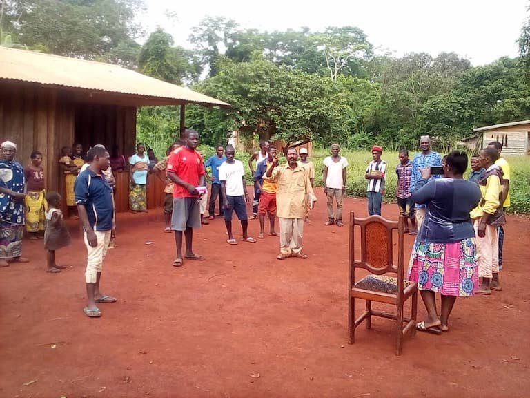 Eastern Cameroon, In the village Mambele, a representative of the NGO Okani is raising awareness of Baka indigenous communities on COVID19 prevention measures. May 2020. Image courtesy of OKANI.