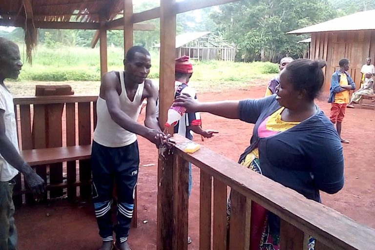 In Mambele, in Eastern Cameroon, an indigenous Baka woman is raising awareness of other Baka indigenous communities on the importance of washing hands to prevent COVID-19. May 2020. Image courtesy of OKANI.