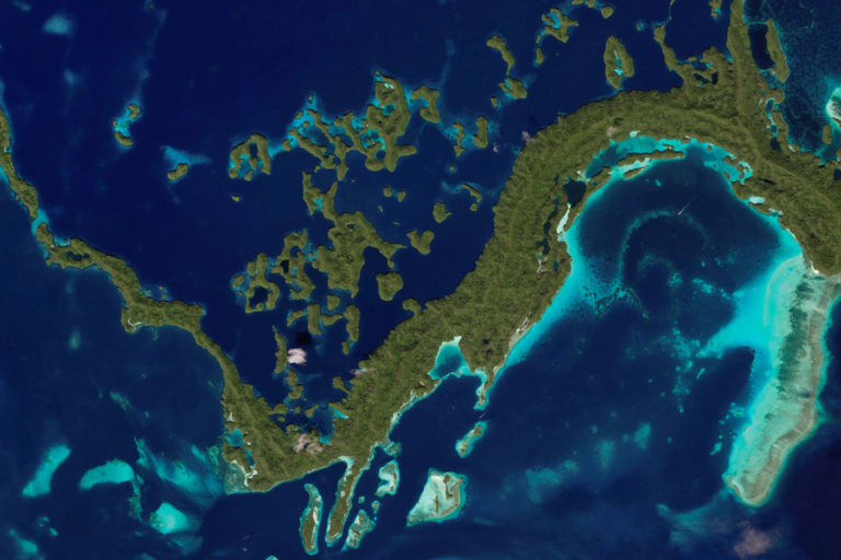 Satellite image of lagoons and reefs in Palau. © Zoom.Earth